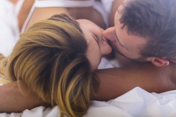 Marriage kissing softly in bed